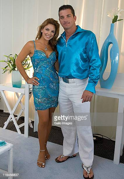 South African celebrity couple Amor Vittone and Joost van der Westhuizen pose together at theDurban July horse race on on July 5 2008 in Durban South...