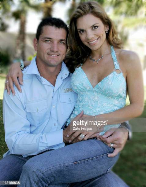 South African celebrity couple Amor Vittone and Joost van der Westhuizen pose for a photo on July 22 2005 in Pretoria South Africa