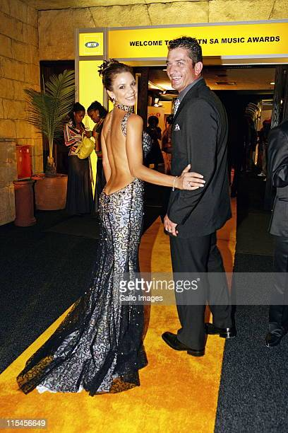 South African celebrity couple Amor Vittone and Joost van der Westhuizen attendt the South African Music Awards on April 13 2007 in South Africa