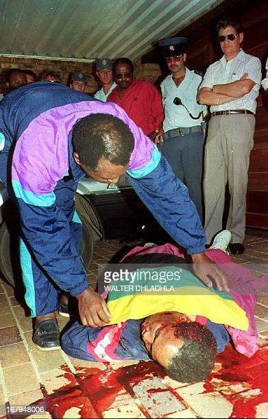 South African Communist Party leader Chris Hani lies dead in front of his home 10 April 1993 Hani reportedly was shot four times in the driveway of...