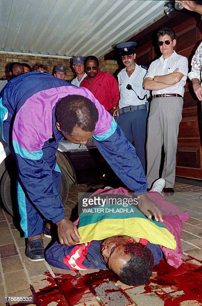 South African Communist Party leader Chris Hani lies dead in front of his home on April 10 1993 after being was shot four times in the driveway of...
