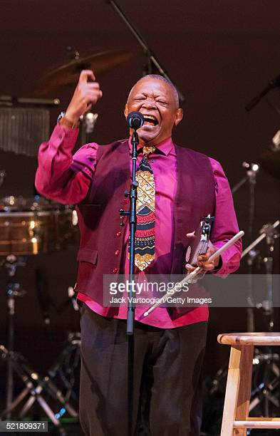 South African composer bandleader and musician Hugh Masekela plays fluegelhorn as he performs onstage at the 'Twenty Years of Freedom' concert during...