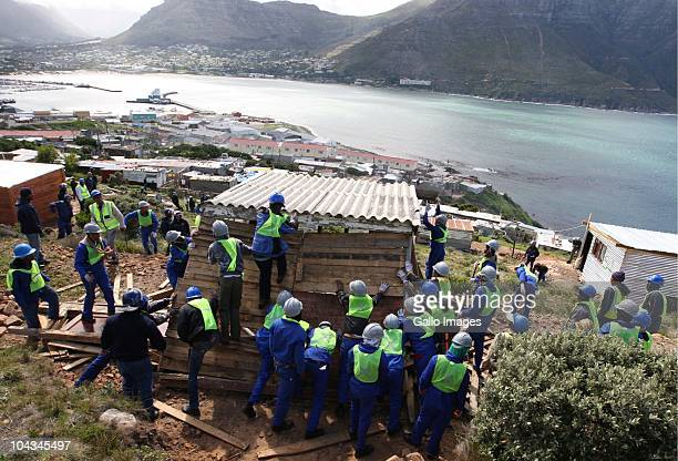 South African council workers break down illegal structures in the informal settlement Hangberg Violence broke out in Hout Bay near Cape Town South...