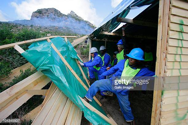 South African council workers break down illegal structures Violence broke out in Hout Bay near Cape Town South Africa on 21 September 2010 when...