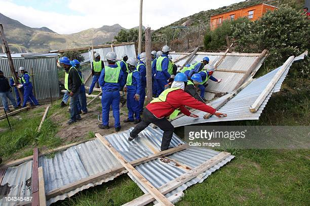 South African council workers remove illegal structres in Hangberg an informal settlement Violence broke out in Hout Bay near Cape Town South Africa...