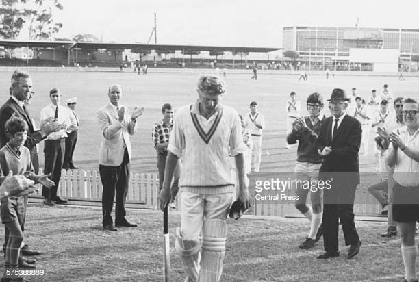 South African cricket player Barry Richards is applauded as he leaves the field after scoring an undefeated 525 at a Sheffield Shield match against...