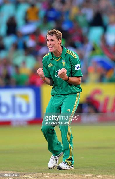 South African cricket player Chris Morris celebrates his first wicket of New Zealand batsman Colin Munro during the T20 cricket match between South...