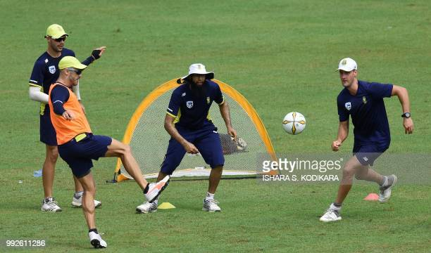 South African cricket team captain Faf du Plessis plays football with teammates Hashim Amla Theunis de Bruyn and Aiden Markram during a practice...