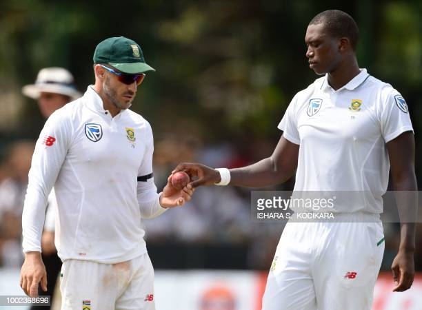 South African cricket team captain Faf du Plessis speaks with Lungi Ngidi during the first day of the second Test match between Sri Lanka and South...