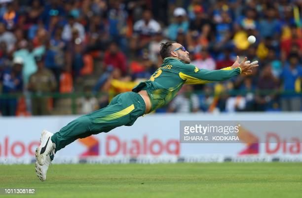 South African cricket team captain Faf du Plessis tries to catch a shot by Sri Lankan cricketer Thisara Perera during the third One Day International...