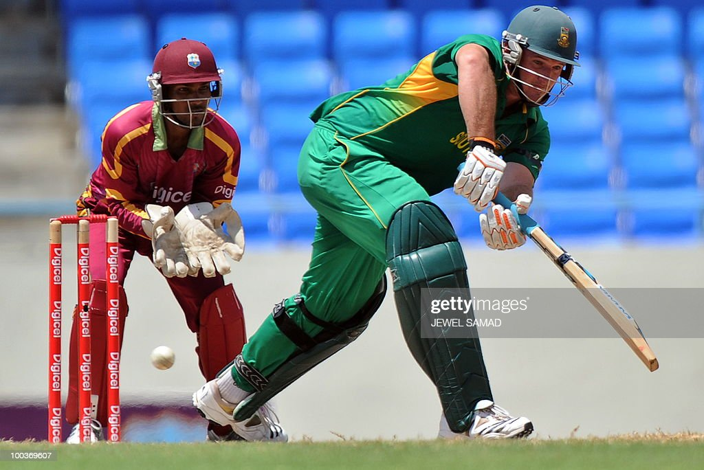 South African cricket team captain Graeme Smith plays a shot as West Indies wicketkeeper Denesh Ramdin looks on during the second One Day International match between West Indies and South Africa at the Sir Vivian Richards Stadium in St John's on May 24, 2010. AFP PHOTO/Jewel Samad