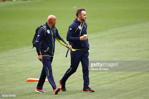 South African cricket team security chief Zunaid Wadee and South African Test cricket captain Faf du Plessis leaves the Adelaide Oval after a hearing...