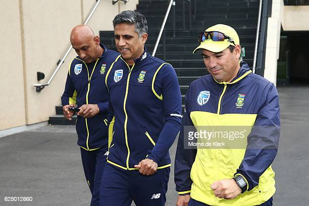 South African cricket team staff LR security chief Zunaid Wadee team manager Dr Mohammed Moosajee and Coach Russell Domingo leave a press conference...