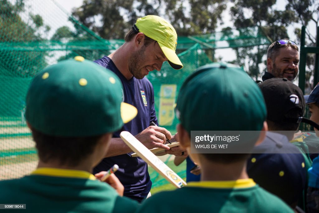 South African cricketer AB de Villiers signs autographs on cricket items for young fans within a team practice session on March 29, 2018 in Johannesburg, in the midst of a growing cheating scandal engulfing Test rivals Australia. South Africa will aim to take advantage of a scandal-hit Australian team in the fourth and final Test starting at the Wanderers Stadium on March 30. /