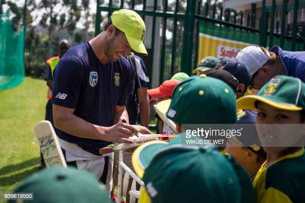 South African cricketer AB de Villiers signs autographs on cricket items for young fans within a team practice session on March 29 2018 in...