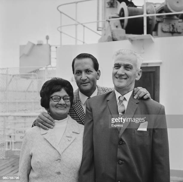 South African cricketer Basil D'Oliveira greets his parents upon their arrival in Southampton UK 30th September 1969