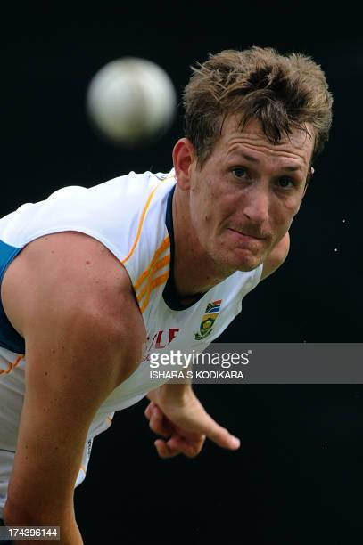 South African cricketer Chris Morris delivers a ball during a practice session at the Pallekele International Cricket Stadium in Pallekele on July 25...