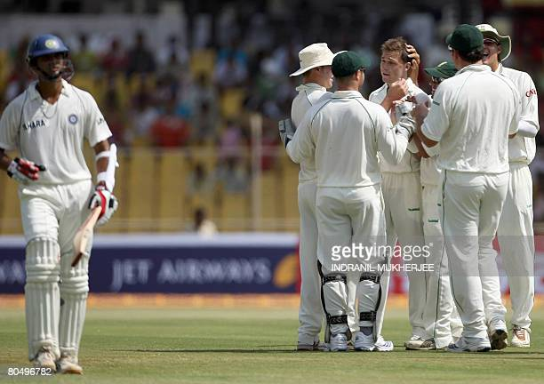 South African cricketer Dale Steyn is congratulated by teammates for taking the wicket of Indian cricketer Rahul Dravid on the first day of the...