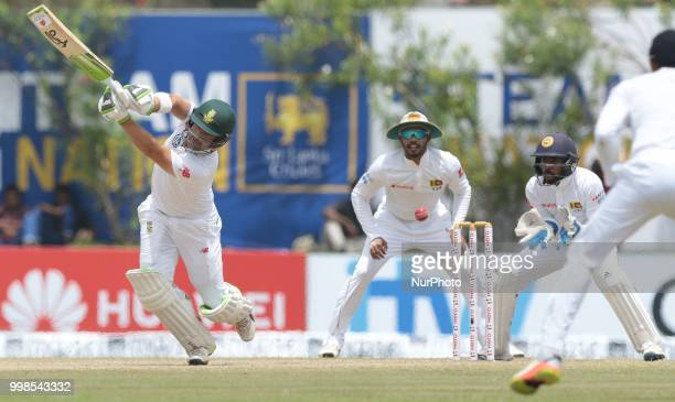 South African cricketer Dean Elgar misses the ball and gets stumed by Sri Lankan wicketkeeper Niroshan Dickwella during the 3rd day's play in the...