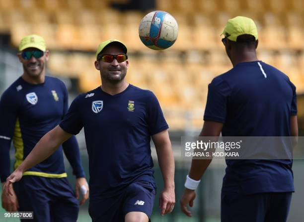 South African cricketer Dean Elgar plays football with teammates during a practice session at the R Premadasa Stadium in Colombo on July 5 2018 South...