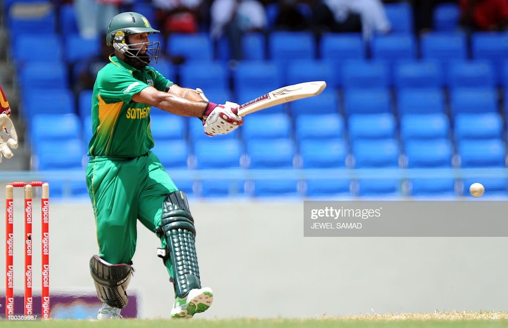 South African cricketer Hashim Amla hits the ball during the second One Day International match between West Indies and South Africa at the Sir Vivian Richards Stadium in St John's on May 24, 2010. AFP PHOTO/Jewel Samad