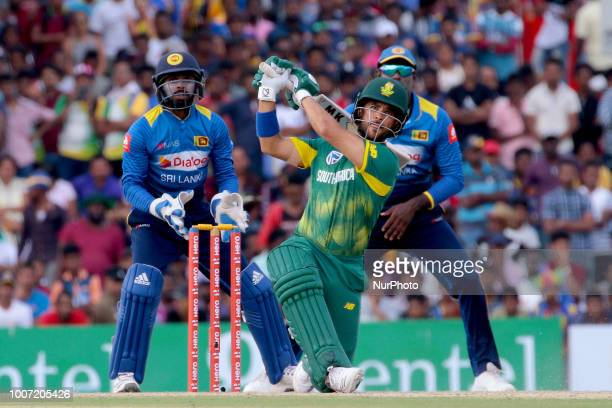 South African cricketer JeanPaul Duminy plays a shot during the 1st One Day International cricket match between Sri Lanka and South Africa at Rangiri...