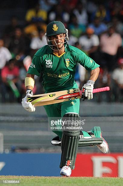 South African cricketer JeanPaul Duminy runs between the wickets during the ICC Twenty20 Cricket World Cup's Super Eight match between South Africa...