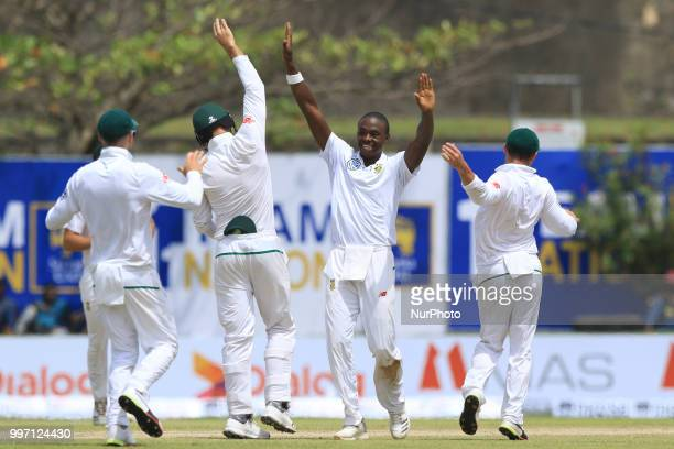 South African cricketer Kagiso Rabada celebrates after taking a wicket during the 1st Day's play of the 1st Test match between Sri Lanka and South...