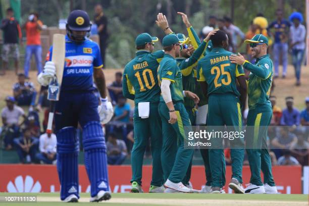 South African cricketer Kagiso Rabada celebrates celebrates with team members during the 1st One Day International cricket match between Sri Lanka...
