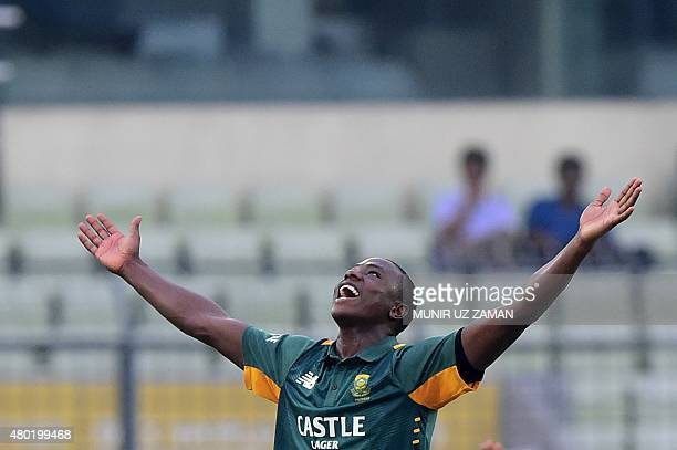 South African cricketer Kagiso Rabada celebrates the wicket of Bangladesh cricketer Mohammad Mahmudullah during the first OneDay International match...