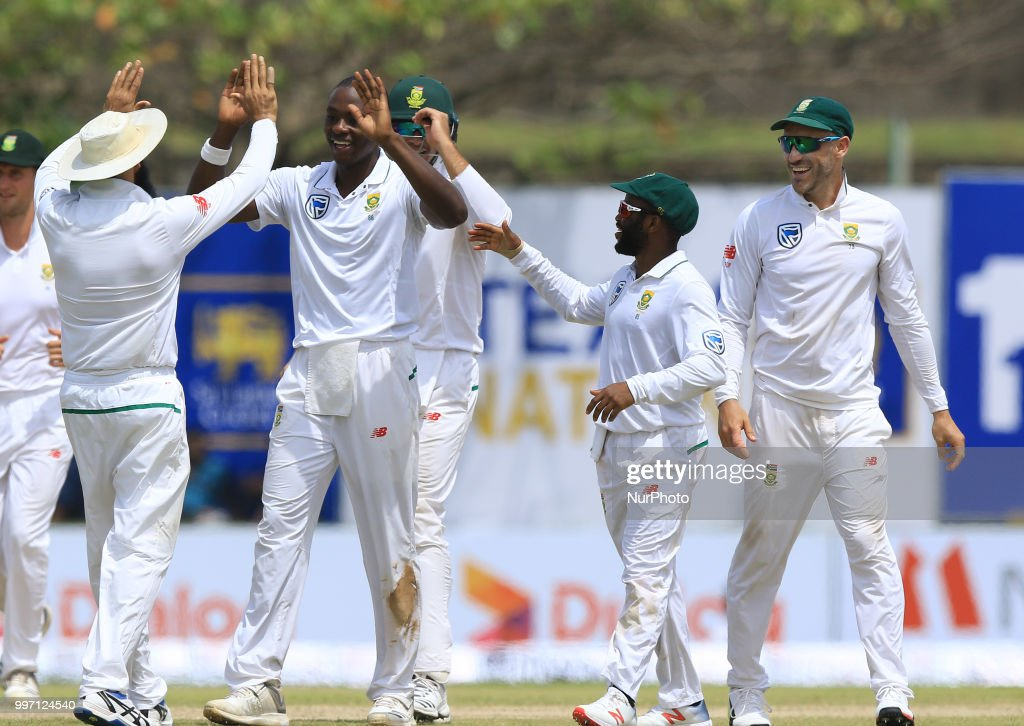 South African cricketer Kagiso Rabada celebrates with his captain Faf du Plessis after taking a wicket during the first day's play in the 1st Test cricket match between Sri Lanka and South Africa at Galle International cricket stadium, Galle, Sri Lanka on Thursday 12 July 2018