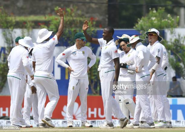 South African cricketer Kagiso Rabada celebrates with his team members during the 3rd day's play in the first Test cricket match between Sri Lanka...