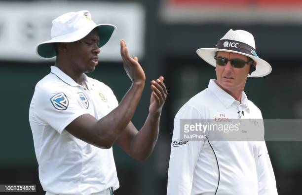 South African cricketer Kagiso Rabada gestures to on field umpire Rod Tucker during the first day of the 2nd test cricket match between Sri Lanka and...