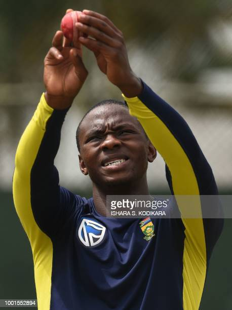 South African cricketer Kagiso Rabada inspects a ball during a training session at the Sinhalese Sports Club international cricket stadium at the...