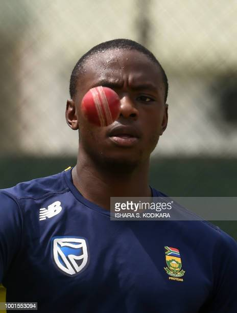 South African cricketer Kagiso Rabada tosses a ball during a training session at the Sinhalese Sports Club international cricket stadium at the...