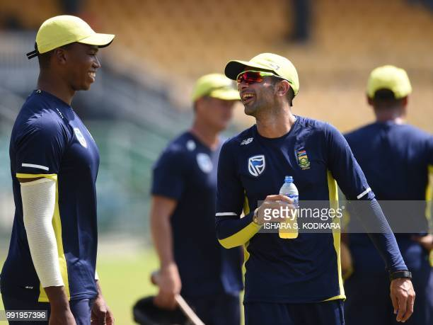 South African cricketer Keshav Maharaj chats with team member Lungi Ngidi during a practice session at the R Premadasa Stadium in Colombo on July 5...