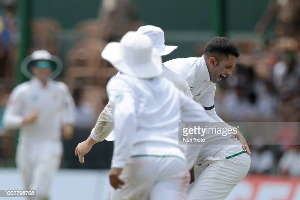 South African cricketer Keshav Maharaj is lifted by Kagiso Rabada during the first day of the 2nd test cricket match between Sri Lanka and South...