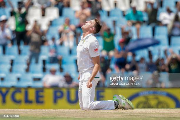 TOPSHOT South African cricketer Morne Morkel celebrates the dismissal of Indian batsman Lokesh Rahul during the second day of the second Test cricket...