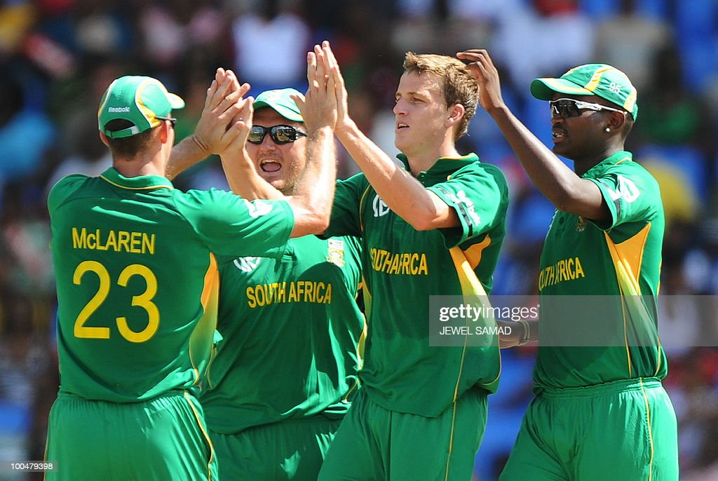 South African cricketer Morne Morkel (C) celebrates with teammates after dismissing West Indies cricket team captian Chris Gayle during the second One Day International match between West Indies and South Africa at the Sir Vivian Richards Stadium in St John's on May 24, 2010. Batting first, South Africa scored 300-runs at the end of their innings. AFP PHOTO/Jewel Samad