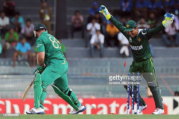 South African cricketer Richard Levi is bowled out by Saeed Ajmal as Pakistan wicketkeeper Kamran Akmal reacts during the ICC Twenty20 Cricket World...