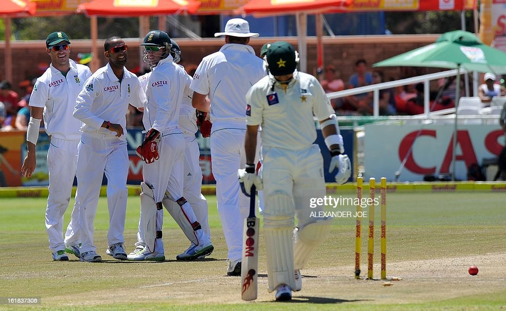 South African cricketer Robin Peterson celebrates the wicket of unseen Pakistan cricketer Saeed Ajmal on day four of the second test between South Africa and Pakistan in Cape Town at Newlands on February 17, 2013.