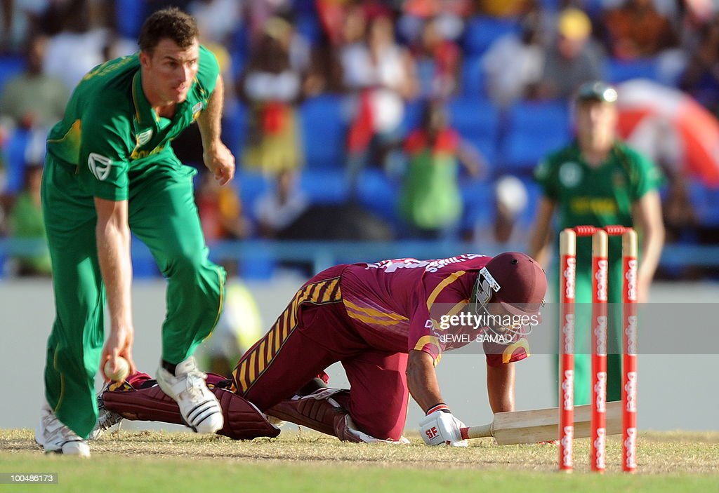 South African cricketer Ryan McLaren (L) runs out West Indies batsman Ravi Rampaul during the second One Day International match between West Indies and South Africa at the Sir Vivian Richards Stadium in St John's on May 24, 2010. South Africa defeated West Indies by 17-runs. AFP PHOTO/Jewel Samad