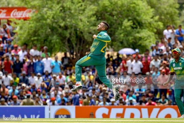 South African cricketer Tabraiz Shamsi celebrates after taking a wicket during the 1st One Day International cricket match between Sri Lanka and...