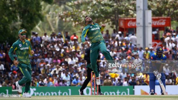 South African cricketer Tabraiz Shamsi celebrates during the 1st One Day International cricket match between Sri Lanka and South Africa at Rangiri...