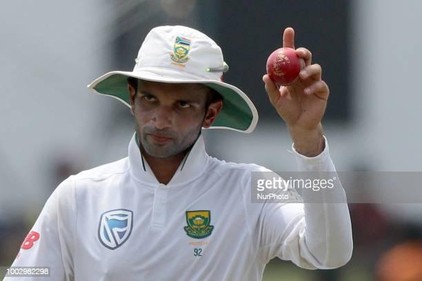 South African cricketer Theunis de Bruyn looks on after his dismissal as Sri Lankan cricket team members Angelo Mathews Kusal Mendis Niroshan...