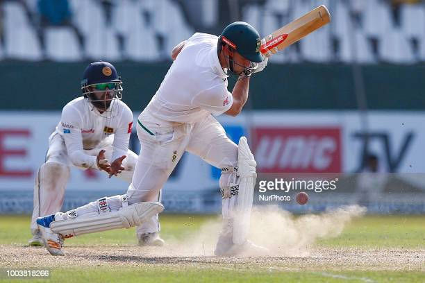 South African cricketer Theunis de Bruyn plays a shot as puff of dust comes out from the pitch during the 3rd day's play in the 2nd test cricket...