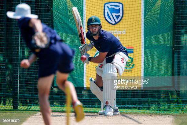 South African cricketer Theunis de Bruyn practices batting during a team practice session on March 29 2018 in Johannesburg in the midst of a growing...