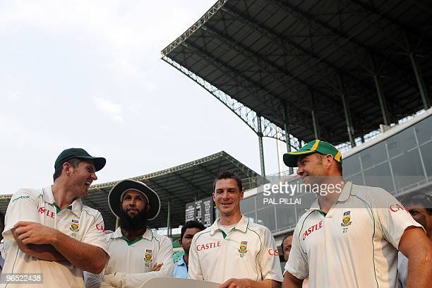 South African cricketers captain Graeme Smith Hashim Amla Dale Steyn and Jacques Kallis share a joke during the presentation of the awards on the...
