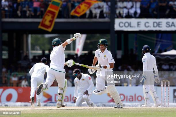 South African cricketers Dean Elgar and Aiden Markram avoid a midpitch collision during the 3rd day's play in the 2nd test cricket match between Sri...