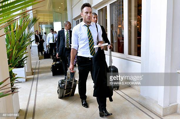 South African cricketers Faf du Plessis Beuran Hendricks and Aaron Phangiso arrive at a hotel in Colombo on June 30 2014 South Africa will play three...